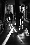France. Pariis, 1st district ,  Royal palace Garden, pedestrians shadows under the arches  / Jardin du palais royal