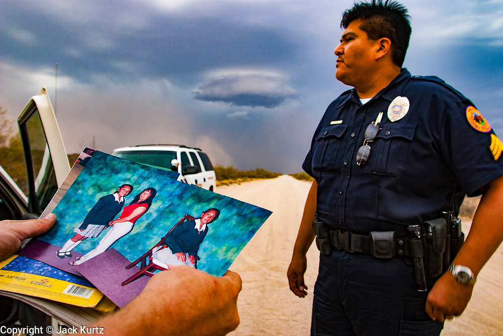 15 JULY 2003 - SELLS, AZ: A Tohono O'odham police sargeant starts the search for an undocumented immigrant feared lost in the desert west of the reservation capitol, Sells, on the Tohono O'odham Reservation southwest of Tucson, AZ. The immigrant, and five other undocumented immigrants were found dead in the desert during the search.    PHOTO BY JACK KURTZ