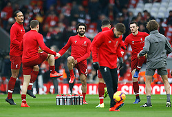 Liverpool's Mohamed Salah (centre) warms up with team-mates before the Premier League match at Anfield, Liverpool.