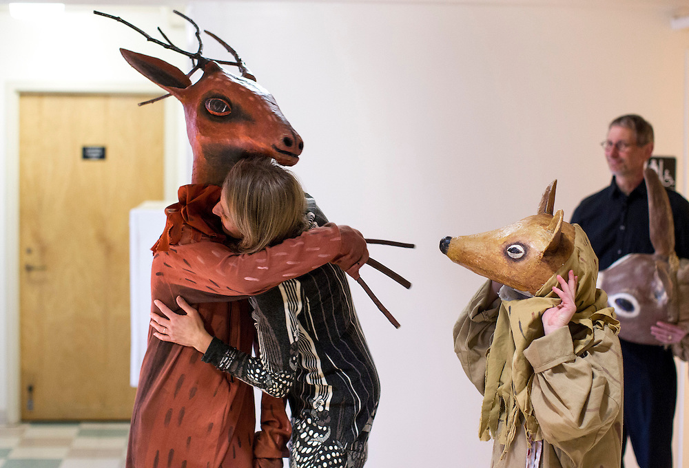 Janel Schliemann hugs her son, Ben, 11, before he makes his appearance as a deer in the Palm Sunday Family Mass presented in collaboration with Heart of the Beast Puppet and Mask Theatre at Saint Joan of Arc Catholic Community in Minneapolis April 13, 2014.