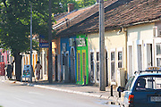 On the boulevard Ivana Cronjevica. Shops in small colourful houses. One shop with a sign saying 'New Industry'. Podgorica capital. Montenegro, Balkan, Europe.