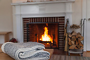Harraseeket Inn-LL Bean Fireplace and wood cradle. Editorial photography for a boston based magazine. Hotel photography and product photography