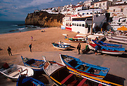 PORTUGAL, ALGARVE, SOUTH COAST Carvoeiro, attractive fishing village now resort, carved into cliffs above the sea, east of Portimao
