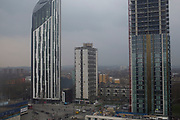 High view of new tower blocks being built as part of the redevelopment of Elephant and Castle in South London, UK. The area is now subject to a master-planned redevelopment budgeted at £1.5 billion. A Development Framework was approved by Southwark Council in 2004. It covers 170 acres and envisages restoring the Elephant to the role of major urban hub for inner South London.