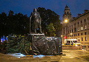 London, United Kingdom - 17 June 2020<br /> Police guard Winston Churchill statue. Its graffiti was being cleaned with solvents after the statue was uncovered from its protective scaffolding and sheet metal following Black Lives Matter protests, Parliament Square, London, England, UK.<br /> (photo by: EQUINOXFEATURES.COM)<br /> Picture Data:<br /> Photographer: Equinox Features<br /> Copyright: ©2020 Equinox Licensing Ltd. +443700 780000<br /> Contact: Equinox Features<br /> Date Taken: 20200617<br /> Time Taken: 22263384<br /> www.newspics.com