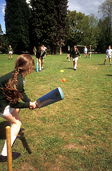 Primary schoolchildren playing cricket, UK