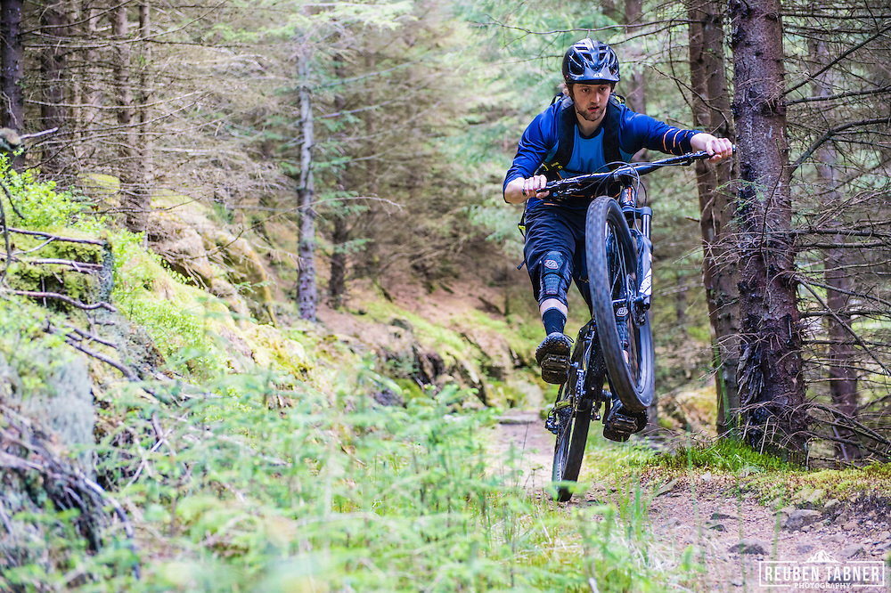 Ed Thomsett pops some style at Kielder Forest on his Vitus Sommet CR.
