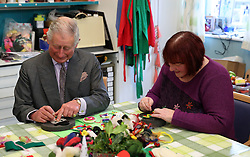 December 22, 2016 - Cheltenham, United Kingdom - Image icensed to i-Images Picture Agency. 22/12/2016. Cheltenham, United Kingdom. The Prince of Wales makes cake decorations  during a visit to the Sue Ryder Leckhampton Court Hospice in  Cheltenham , United Kingdom. Picture by ROTA / i-Images  UK OUT FOR 28 DAYS (Credit Image: © Rota/i-Images via ZUMA Wire)