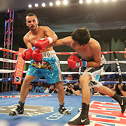 ORLANDO, FL - OCTOBER 04: Francisco Camacho of Mexico (R) punches Christopher Diaz of Puerto Rico during a professional featherweight boxing match at the Bahía Shriners Auditorium & Events Center on October 4, 2014 in Orlando, Florida. (Photo by Alex Menendez/Getty Images) *** Local Caption *** Christopher Diaz; Francisco Camacho