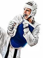 one caucasian man practicing Taekwondo  in studio  isolated on white background