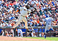 April 8, 2018 - San Francisco, California, U.S. - SAN FRANCISCO, CA - APRIL 08: San Francisco Giants Infield Pablo Sandoval (48) is airborne while he catches the ball and tags out Los Angeles Dodgers Catcher Austin Barnes (15) at during a regular season game between the Los Angeles Dodgers and San Francisco Giants on April 8, 2018, at AT&T Park in San Francisco, CA. (Photo by Stephen Hopson/Icon Sportswire) (Credit Image: © Stephen Hopson/Icon SMI via ZUMA Press)
