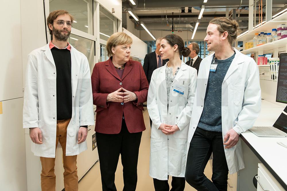 26 FEB 2019, BERLIN/GERMANY:<br /> Angela Merkel (R),  CDU, Bundeskanzlerin, und Jonathan Ronen (L), aus dem Bioinformatik-Labor von Altuna Akalin,  <br /> Zoe Mendelsohn (2.v.R.), Doktorandin aus dem Labor von Nikolaus Rajewsky und Jonathan Alles (R), Doktorand aus dem Labor von Nikolaus Rajewsky, waehrend einem Rundgang der Kanzlerin durch das Labor anl. der Eroeffnung des zweiten Standorts des Max-Delbrueck-Centrums fuer Molekulare Medizin (MDC) in Berlin-Mitte<br /> IMAGE: 20190226-01-0<br /> KEYWORDS: Max-Delbrück-Centrum