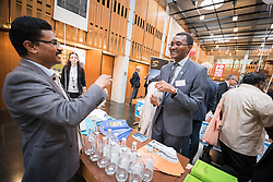 """18 September 2017, Geneva, Switzerland: A """"marketplace"""" at the Ecumenical Centre in Geneva presents resources and activities of the World Council of Churches, at it hosts a meeting of member churches' Ecumenical Officers. Here, Dinesh Suna showcasing a World Council of Churches Blue Community water bottle."""
