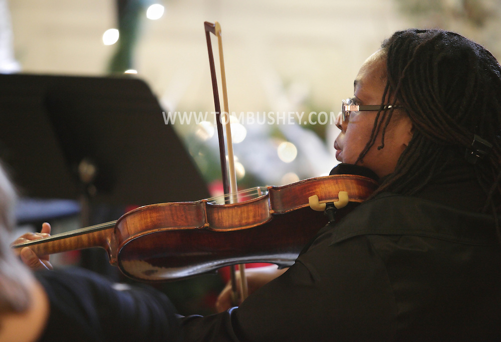 Middletown, New York - A member of the SUNY Orange Chamber Ensemble plays during a concert at the Holiday Open House at the Morrison Hall mansion on Dec. 12, 2010. Morrison Hall was the home of the Morrison family, who donated the mansion to the college in 1950.
