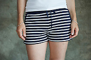 woman wearing blue white striped summer short pants