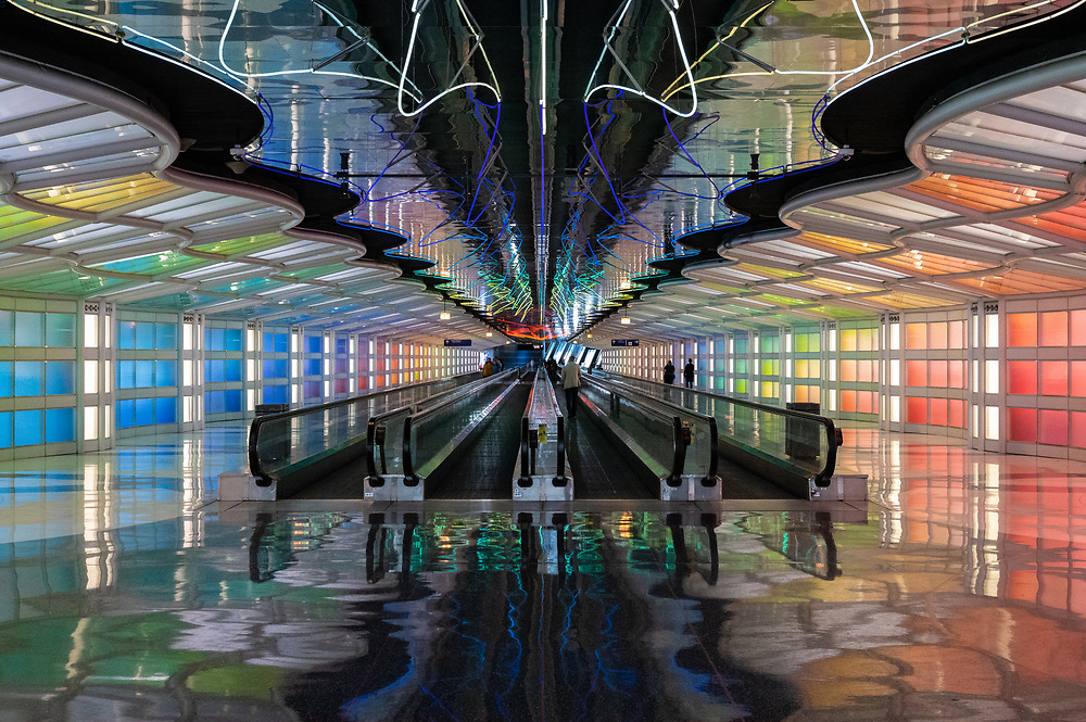 A view of the tunnel, illuminated by neon lighting, between Terminal 1 and Concourse C at O'Hare Airport in Chicago, Illinois.