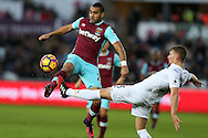 Dimitri Payet of West Ham  is challenged by  Stephen Kingsley of Swansea city. Premier league match, Swansea city v West Ham United at the Liberty Stadium in Swansea, South Wales on Boxing Day, Monday 26th December 2016.<br /> pic by  Andrew Orchard, Andrew Orchard sports photography.
