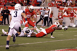 02 September 2017:   Christian Gibbs reaches high for a pass while covered by Isaak Newhouse at the 5 yard line.  Gibbs extends the arm with ball to the endzone for a touch down after returning to the turf during the Butler Bulldogs at  Illinois State Redbirds Football game at Hancock Stadium in Normal IL (Photo by Alan Look)