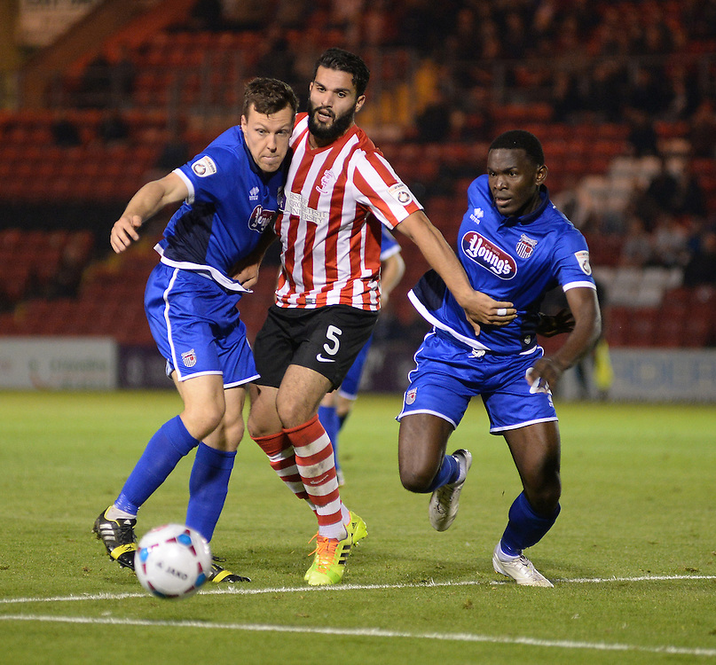 Lincoln City's Hamza Bencherif vies for possession with Grimsby Town's Carl Magnay, left, and Grimsby Town's Aristote Nsiala<br /> <br /> Photo by Chris Vaughan/CameraSport<br /> <br /> Football - English Football Vanarama Conference Premier League - Lincoln City v Grimsby Town - Tuesdayb9th September 2014 - Sincil Bank - Lincoln<br /> <br /> © CameraSport - 43 Linden Ave. Countesthorpe. Leicester. England. LE8 5PG - Tel: +44 (0) 116 277 4147 - admin@camerasport.com - www.camerasport.com