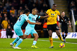 Willy Boly of Wolverhampton Wanderers takes on Jose Salomon Rondon and Isaac Hayden of Newcastle United - Mandatory by-line: Robbie Stephenson/JMP - 11/02/2019 - FOOTBALL - Molineux - Wolverhampton, England - Wolverhampton Wanderers v Newcastle United - Premier League