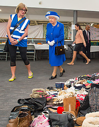 Executive Director of Kensington and Chelsea Council Sue Harris shows Queen Elizabeth II donations of aid made by members of the local community during a visit to the Westway Sports Centre, London, which is providing temporary shelter for those who have been made homeless in the Grenfell Tower disaster.
