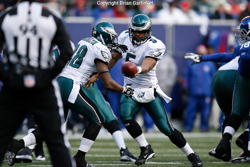11 Jan 2009: Philadelphia Eagles quarterback Donovan McNabb #5 hands the ball off to running back Correll Buckhalter #28 during the game against the New York Giants on January 11th, 2009.  The  Eagles won 23-11 at Giants Stadium in East Rutherford, New Jersey.