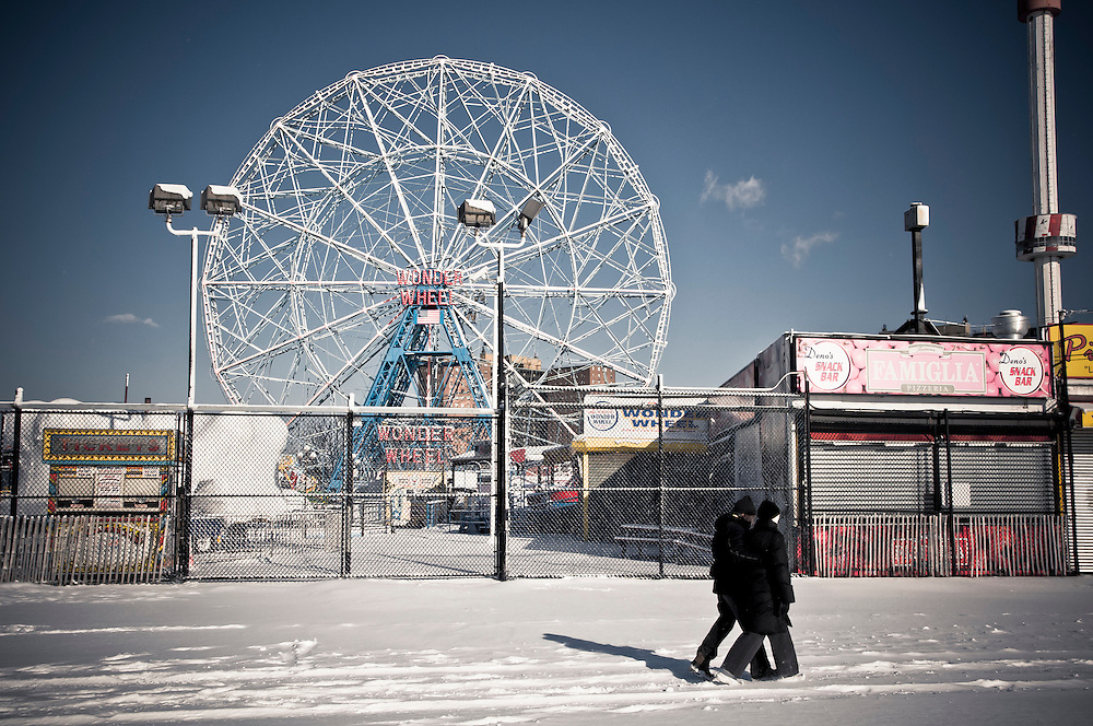 Closed park attractions and empty streets covered with snow during winter at Coney Island, Brooklyn, New York, 2011.