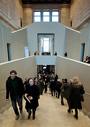 visitors climb main staircase inside the newly renovated Neues Museum on the Museuminsel in central Berlin reopened after many years construction work Architect David Chipperfield March 2009