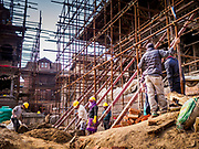13 MARCH 2017 - PATAN, NEPAL: Workers on the project to rebuild ancient Hindu temples in Patan's Durbar Square. Much of historic Durbar Square was badly damaged in the 2015 earthquake.      PHOTO BY JACK KURTZ