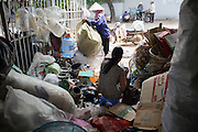 October 2, 2015. Kieu's wife collects recycled items at her home near Hanoi, Vietnam.