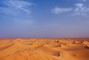 Blue skies and drifting sand dunes in the Sahara Desert, Morocco