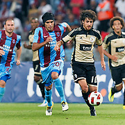 Trabzonspor's Gustavo COLMAN (2ndL) and Benfica's Pablo AIMAR (2ndR) during their UEFA Champions League third qualifying round, second leg, soccer match Trabzonspor between Benfica at the Ataturk Olimpiyat Stadium at İstanbul Turkey on Wednesday, 03 August 2011. Photo by TURKPIX