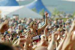 Fans at the main stage on Sunday, T in the Park 2003..Pic: © Michael Schofield.