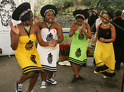 Members of the children of Soweto Gospel Choir perform for Irish president Mary McAleese after the unveiling of a sculpture entitled African Rose Bowl by the president at St Stephens Green, Dublin.
