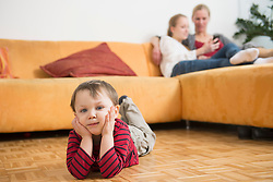Boy feels bored while mother and sister having chat