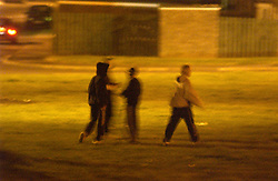 Youths in an urban area of Tyneside at night UK
