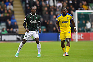 Freddie Ladapo (19) of Plymouth Argyle and Deji Oshilaja (4) of AFC Wimbledon during the EFL Sky Bet League 1 match between Plymouth Argyle and AFC Wimbledon at Home Park, Plymouth, England on 6 October 2018.