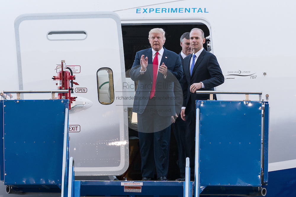 U.S. President Donald Trump stands with Boeing CEO Dennis Muilenburg, right, as they prepare to tour the new Boeing 787-10 Dreamliner aircraft at the Boeing factory February 17, 2016 in North Charleston, SC. Trump is at the factory for the rollout of the new aircraft.