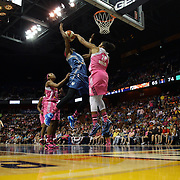 Rebekkah Brunson, (left), Minnesota Lynx, is defended by Kelsey Bone, Connecticut Sun, during the Connecticut Sun Vs Minnesota Lynx, WNBA regular season game at Mohegan Sun Arena, Uncasville, Connecticut, USA. 27th July 2014. Photo Tim Clayton