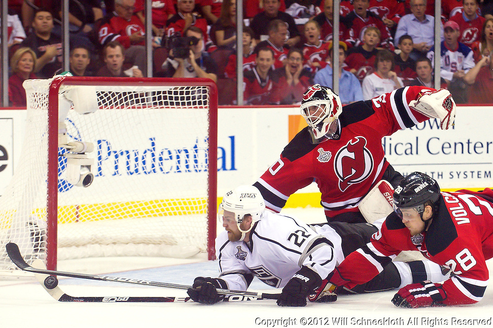 June 9, 2012: New Jersey Devils defenseman Anton Volchenkov (28) stops a Los Angeles Kings center Trevor Lewis (22) diving shot from scoring on New Jersey Devils goalie Martin Brodeur (30) during second period action in game 5 of the NHL Stanley Cup Final between the New Jersey Devils and the Los Angeles Kings at the Prudential Center in Newark, N.J.