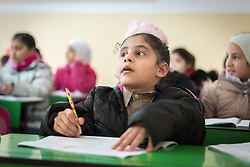 19 February 2020, Amman, Jordan: 10-year-old Bayan, a girl born with Cerebral Palsy, attends class at the Al Yarmouk Primary Mixed School, in the Lewa'a Al Jama'a district.  Following three years in a school exclusively for children with disabilities, today she attends 4th grade at Al Yarmouk, which has recently opened up to receive her. The school teaches some 750 students from 1st - 6th grade, most of them Jordanian, but some also from Syria and other countries. The school has received support from the Lutheran World Federation in refurbishing their buildings and classrooms, as well as training on protection and social cohesion, including how to become more inclusive of children with disabilities.