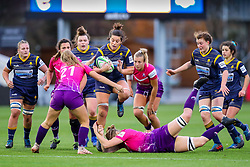 Sioned Harries of Worcester Warriors Women is restrained by the visiting defence - Mandatory by-line: Nick Browning/JMP - 14/11/2020 - RUGBY - Sixways Stadium - Worcester, England - Worcester Warriors Women v Loughborough Lightning - Allianz Premier 15s