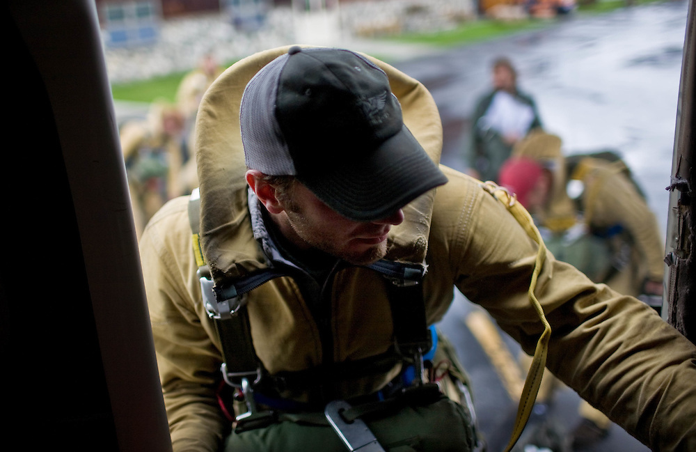 Travis Dotson enters a Twin Otter plane for live proficiency jumps at the McCall Smokejumper base in McCall, ID.