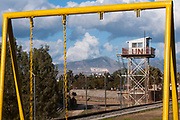 A guard tower, next to a playground, with the turkish and the turkish cypriot flags in the UN buffer zone in Nicosia, Cyprus.<br /> Nicosia was divided into the southern Greek Cypriot and the northern Turkish Cypriot parts in 1963, following the intercommunal violence that broke out in the city. Today, the northern part of the city is the capital of Northern Cyprus, a de facto state that is considered to be occupied Cypriot territory by the international community. ©Simone Padovani / Awakening