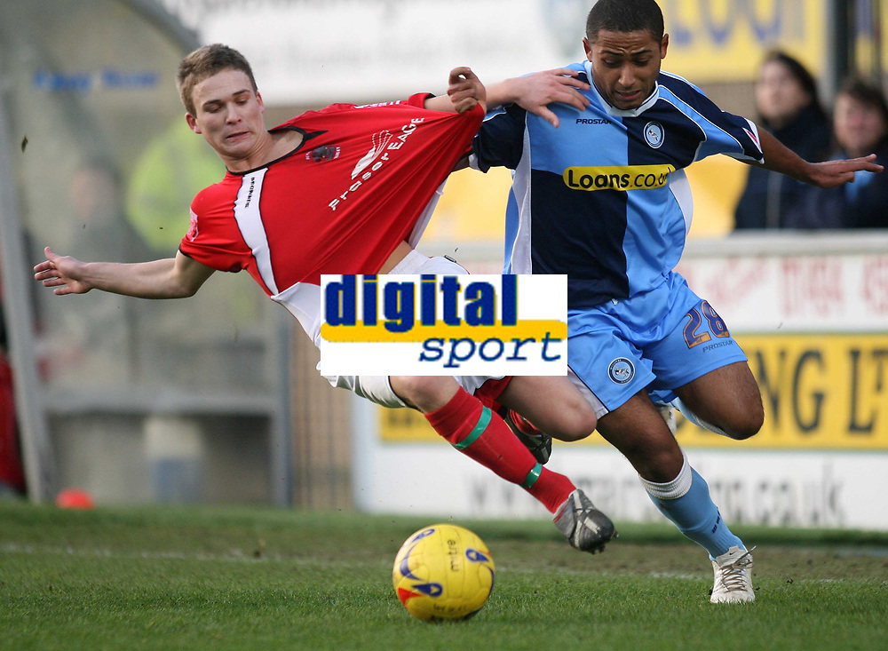 Photo: Marc Atkins.<br /> Wycombe Wanderers v Accrington Stanley. Coca Cola League 2. 20/01/2007.<br /> Jay Harris (L) of Accrington in action with Ikechi Anya of Wycombe.