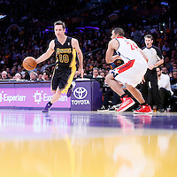 21 March 2014: Los Angeles Lakers guard Steve Nash (10) drives past Washington Wizards guard Andre Miller (24) during the Washington Wizards 117-107 victory over the Los Angeles Lakers at the Staples Center, Los Angeles, California, USA.