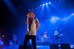 "© Licensed to London News Pictures. 08/06/2012. London, UK. The Charlatans perform live at Hammersmith Apollo, playing their 1997 and fifth studio album ""Telling' Stories"" in its entirety.  In this picture L to R -  Martin Blunt, Tim Burgess, Jon Brookes, Mark Collins.   Photo credit : Richard Isaac/LNP"