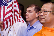 July 4, 2008 -- Phoenix, AZ: A Buddhist monk, originally from Thailand, waves an American flag during his naturalization ceremony in Phoenix, AZ, Friday. About 300 people from 41 countries were naturalized as US citizens at South Mountain Community College, in Phoenix, AZ, Friday. It was the 20th year the college has hosted the Fiesta of Independence. More than 5,000 people have become naturalized US citizens at the Fiesta of Independence. More than 5,000 people have become naturalized US citizens at the Fiesta of Independence. The largest number of new citizens, 158, came from Mexico. There were also large numbers of new citizens from the Philippines, Bosnia-Herzegovnia and India.  Photo by Jack Kurtz