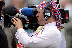 © Licensed to London News Pictures. 02/06/2012. London, UK. A television camera man dresses for the occasion. HRH Queen Elizabeth at The Investic Derby Festival today 2nd June 2012. The Royal Jubilee celebrations. Great Britain is celebrating the 60th  anniversary of the countries Monarch HRH Queen Elizabeth II accession to the throne this weekend Photo credit : Stephen Simpson/LNP