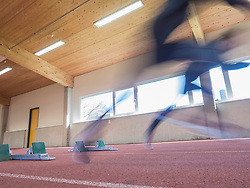 Blurred motion of two women running on tartan track, Offenburg, Baden-Wuerttemberg, Germany